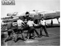 Navy Planes Blast Foe With Rockets --Spotted on the flight deck of a US Navy Aircraft Carrier, this Grumman Avenger Torpedo Bomber is equipped to hurl rockets at the enemy. These new missiles have been employed against U-Boats in the Atlantic and Jap shipping in the Pacific. This rocket installations are plainly visible on the under side of the plane's wing.  June 22, 1944