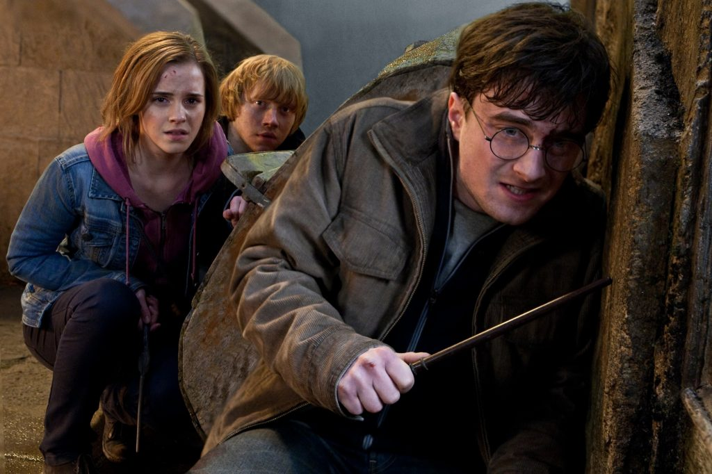 "(L-r) EMMA WATSON as Hermione Granger, RUPERT GRINT as Ron Weasley and DANIEL RADCLIFFE as Harry Potter in Warner Bros. Pictures' fantasy adventure ""HARRY POTTER AND THE DEATHLY HALLOWS – PART 2,"" a Warner Bros. Pictures release."